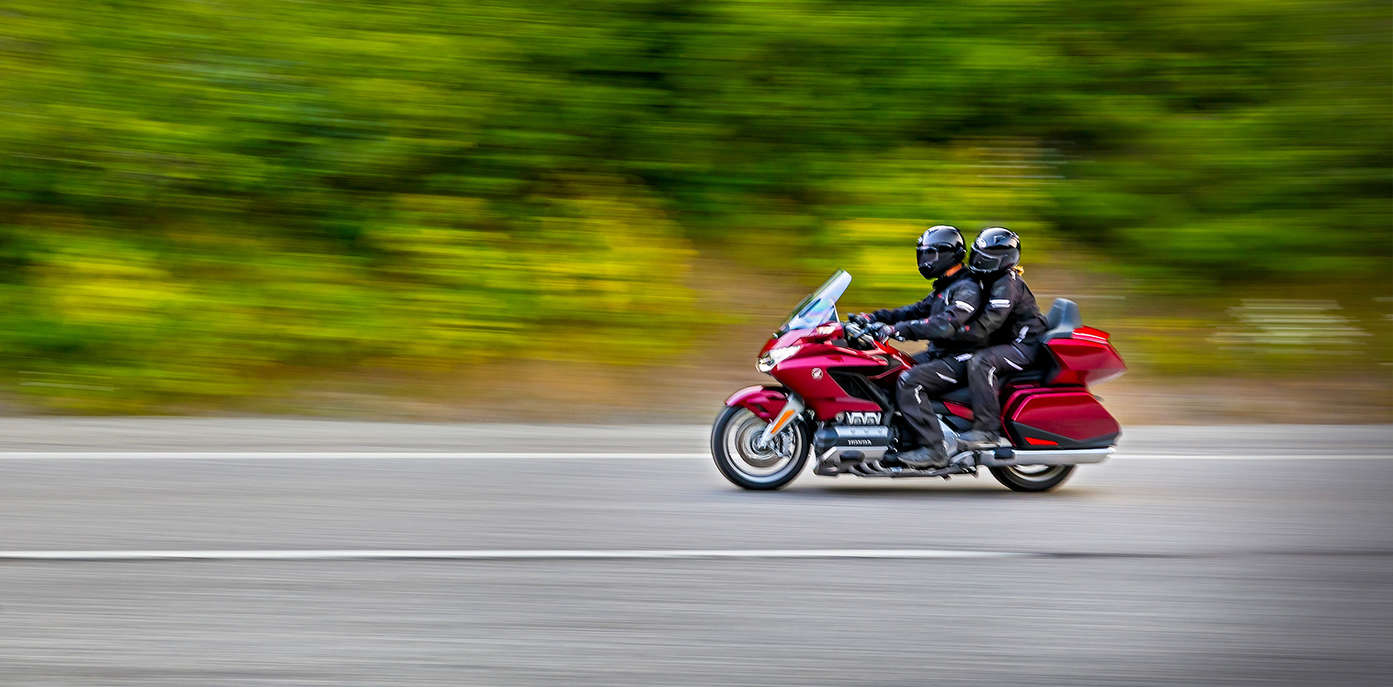 Rider and pillion passenger on a Honda Goldwing.